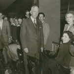 General George C. Marshall talks things over with Junior Red Cross members at a luncheon held in the Red Cross President's honor during his visit to Oklahoma City, Oklahoma. Jan. 1950