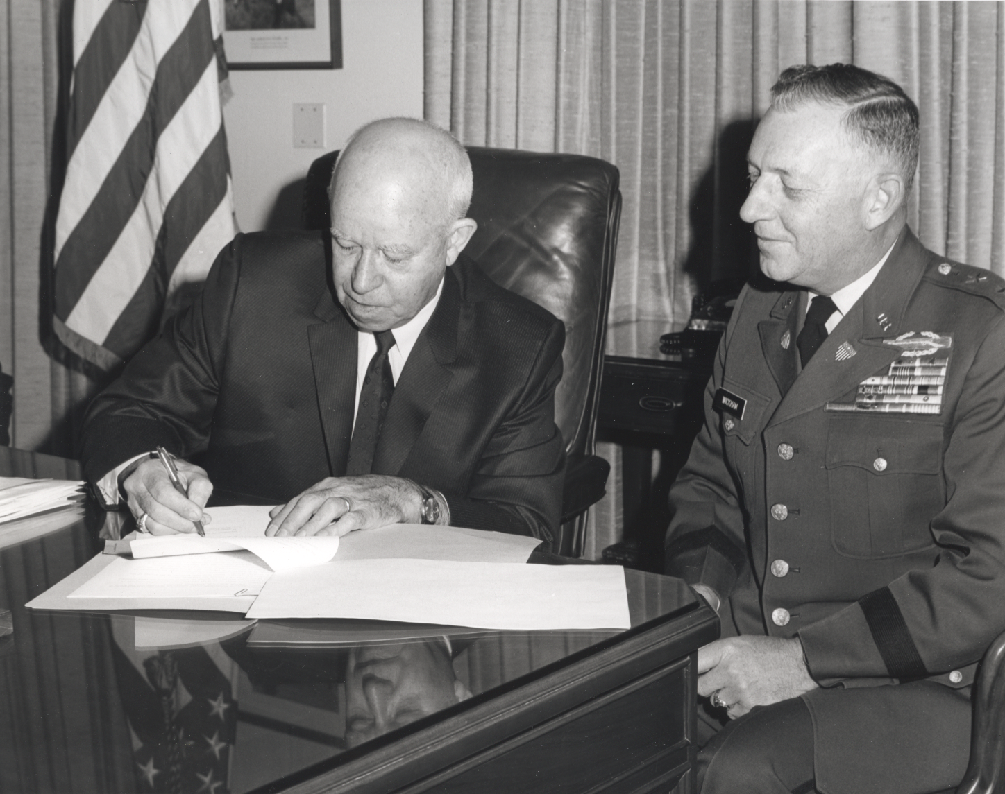 General of the Army and President of the George C. Marshall Foundation, and Maj. Gen. Kenneth G. Wickham, Adjutant General, sign paperwork on Nov. 9, 1967, giving the George C. Marshall Foundation Archives in Lexington, VA, permission to receive classified Army records.