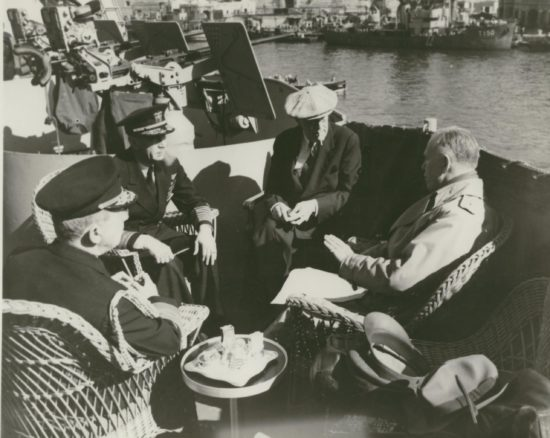 Meeting topside: Adm. Leahy, Adm. King, President Roosevelt, and Gen. Marshall
